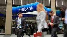 People walk by a Citibank office in midtown Manhattan on April 19, 2010 in New York City. Citigroup Inc. has reported a first-quarter net income of $4.43 billion, its strongest results in nearly three years. (Spencer Platt/Getty Images/Spencer Platt/Getty Images)