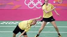 Canada's Michele Li (L) and Alex Bruce play against Japan's Mizuki Fujii and Reika Kakiiwa during their womens doubles semifinals match during the London 2012 Olympic Games at the Wembley Arena August 2, 2012. (BAZUKI MUHAMMAD/REUTERS)