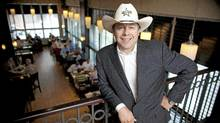 """Calgary bar owner Paul Vickers who runs Penny Lane Entertainment, has built a 50,000 sq. foot tent on the grounds of the Calgary Stampede and once again will open the famous """"cowboys"""" nightclub. (Chris Bolin Photography Inc./CHRIS BOLIN / FOR THE GLOBE AND MAIL)"""