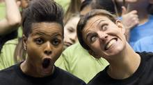 Team Canada's Karina LeBlanc, left, and Christine Sinclair make faces as FIFA unveils the official emblem for the 2015 Women's World Cup soccer tournament during a ceremony in downtown Vancouver, B.C. Friday, December, 14, 2012. (Jonathan Hayward/THE CANADIAN PRESS)