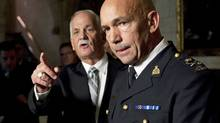 Minister of Public Safety Vic Toews calls on a reporter as newly appointed RCMP Commissioner Bob Paulson takes questions in the foyer of the House of Commons on Nov. 16, 2011. (Adrian Wyld/Adrian Wyld/The Canadian Press)