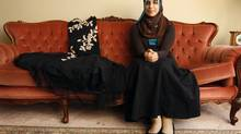 Salma Hindy sits beside her prom dress at her home hours before heading to her prom night. (Charla Jones/Charla Jones/The Globe and Mail)