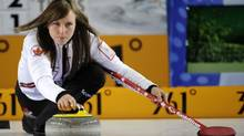 Canada's skip Rachel Homan delivers the stone during the bronze medal game (Roman Koksarov/AP)