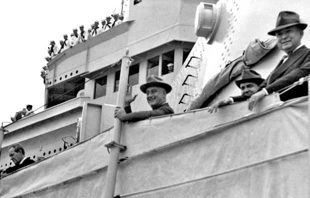 Dec. 3, 1940: President Franklin D. Roosevelt waves to crowd while aboard the USS Tuscaloosa in Miami.