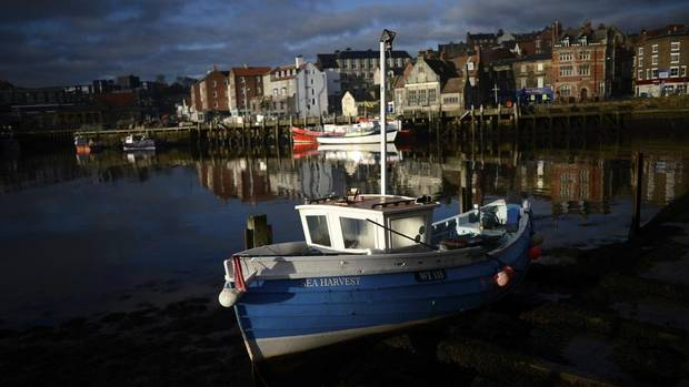 Small fishing boats dry out in the morning sun by the quayside in Whitby, northern England, Feb. 27, 2013. Whitby, once a busy fishing port, is now a shadow of its former self. (DYLAN MARTINEZ/REUTERS)