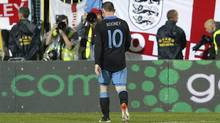 England's Wayne Rooney leaves the pitch after being sent off by referee Wolfgang Stark during their Euro 2012 Group G qualifying soccer match against Montenegro. (DARREN STAPLES/Reuters)