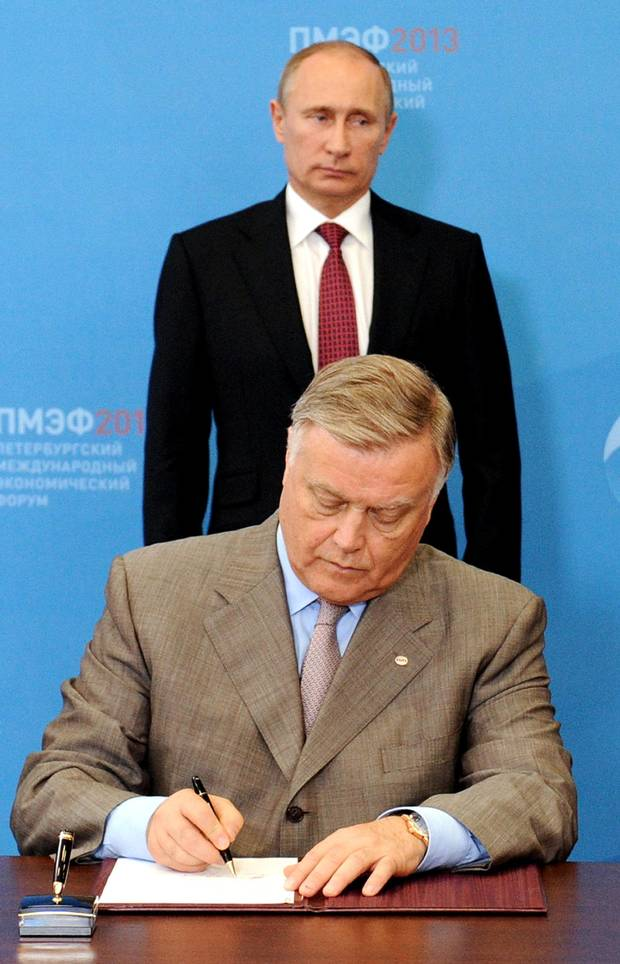 Russia's President Vladimir Putin and then-Russian Railways head Vladimir Yakunin in St. Petersburg, on June 20, 2013.