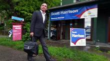 Liberal supporter Antonio Arias walks beside the campaign office of Liberal candidate Scott Harrison in the West End of Vancouver, B.C. May 13, 2013. (Jeff Vinnick/The Globe and Mail)