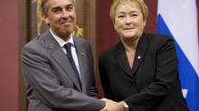 Quebec Premier Pauline Marois poses with Finance Minister Nicolas Marceau. (JACQUES BOISSINOT/THE CANADIAN PRESS)