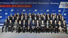 Finance ministers and central bank governors pose for a family photo during a meeting of G20 finance ministers and central bank governors at the Manezh Exhibition Center in Moscow, Feb. 16, 2013. (SERGEI KARPUKHIN/REUTERS)