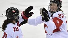 Canada's Catherine Ward and Hayley Wickenheiser celebrate a goal against Switzerland (Nathan Denette/The Canadian Press)