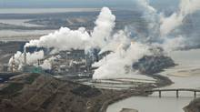 In response to provinces' concerns about oil sands development and emissions, the federal Environment Department says all sectors will be treated equally. (MARK RALSTON)