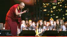 "Exiled Tibetan spiritual leader the Dalai Lama talks to the audience while attending the ""Free The Children - We Day"" at GM Place in Vancouver. (ANDY CLARK/Andy Clark/Reuters)"