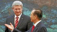 Canada's Prime Minister Stephen Harper looks on as Chinese Premier Wen Jiabao gestures (R) after a signing ceremony at the Great Hall of the People in Beijing Feb. 8, 2012. (Diego Azubel/Reuters/Diego Azubel/Reuters)