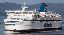BC Ferries vessel Spirit of Vancouver Island passes between Galiano Island and Mayne Island while travelling from Swartz Bay to Tsawwassen, B.C., in August 2011. (DARRYL DYCK/THE CANADIAN PRESS)