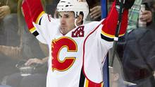 Calgary Flames' Curtis Glencross celebrate a goal against the Edmonton Oilers during second period NHL hockey action in Edmonton on Saturday. (JASON FRANSON/THE CANADIAN PRESS)