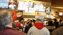 Customers line up at Tim Hortons coffee shop on Queen St., Toronto on February 20, 2014. (FERNANDO MORALES/THE GLOBE AND MAIL)