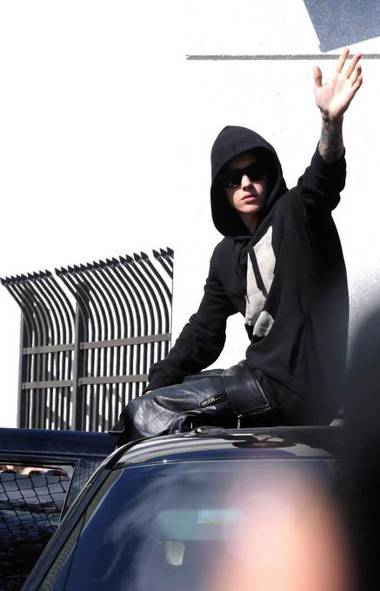 Last week on Leave It to Bieber, our hero was seen bidding adieu to sunny Florida following a brush with Miami Beach po-po and a few criminal charges that will fade faster than a Spring Break tan. What might the next adventure be for this incorrigible Canadian scamp? (Hector Gabino/AP)