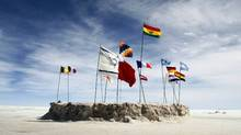 Flags left by tourists from various countries wave in the wind from a salt formation in the middle of the Salar de Uyuni, the world's biggest salt desert. (JOSE LUIS QUINTANA/JOSE LUIS QUINTANA/REUTERS)