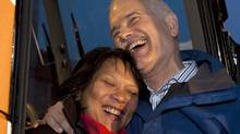 NDP Leader Jack Layton hugs his wife Olivia Chow on the steps of his campaign bus as he addresses supporters in Toronto on Sunday, May 1, 2011. (Andrew Vaughan/ The Canadian Press/Andrew Vaughan/ The Canadian Press)