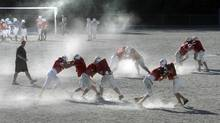 High school football in North Vancouver, British Columbia. (file photo) (© Reuters Photographer / Reuter/REUTERS/Andy Clark)