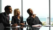Boardroom presentation (Stockbyte/Photos.com)