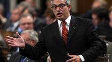 Treasury Board President Tony Clement rises during Question Period in the House of Commons in Ottawa, Tuesday Sept. 25, 2012. (Adrian Wyld/THE CANADIAN PRESS)