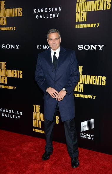 Is there a more confident man in Hollywood today than George Clooney? At 52, the former ER star has his pick of females, trendy causes and movie projects. Here the handsome devil shows up at the New York premiere of The Monuments Men, a film he co-produced, co-wrote, directed and stars in. Such a multi-tasker! (Evan Agostini/Evan Agostini/Invision/AP)