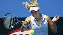 Aleksandra Wozniak hits a return at the Australian Open on Jan. 17, 2012. (Vivek Prakash/Reuters/Vivek Prakash/Reuters)