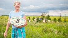 "A month after the floods, Helen (Jette) Fraser, 71, was upbeat. She was living in a tent, but had saved the welcome sign from her old home, which reads 'Her Bor ""Jeg"" Jette,' or 'here lives I, Jette.' Now, she says, her identity is shaken. (Chris Bolin For The Globe and Mail)"