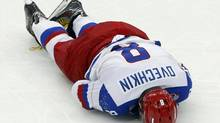 Russia's Alexander Ovechkin lies on the ice during the third period of a World Championship Group B game against Germany at Minsk Arena, May 18, 2014. (ALEXANDER DEMIANCHUK/REUTERS)