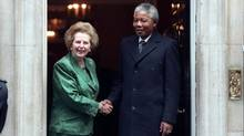 African National Congress leader Nelson Mandela is greeted by British Prime Minister Margaret Thatcher at 10 Downing Street in this July 4, 1990 file photo. (RUSSELL BOYCE/Reuters)