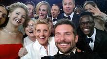 "This image released by Ellen DeGeneres shows actors front row from left, Jared Leto, Jennifer Lawrence, Meryl Streep, Ellen DeGeneres, Bradley Cooper, Peter Nyong'o Jr., and, second row, from left, Channing Tatum, Julia Roberts, Kevin Spacey, Brad Pitt, Lupita Nyong'o and Angelina Jolie as they pose for a ""selfie"" portrait on a cellphone during the Oscars at the Dolby Theatre on Sunday, March 2, 2014, in Los Angeles. (Ellen DeGeneres/AP)"