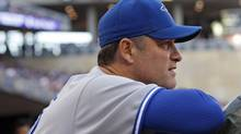 Toronto Blue Jays manager John Farrell watches the action against the Minnesota Twins during the fourth inning of their American League MLB baseball game at Target Field in Minneapolis, May 12, 2012. REUTERS/Eric Miller (Eric Miller/Reuters)