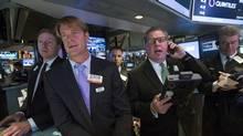 Traders work on the floor at the New York Stock Exchange (BRENDAN MCDERMID/REUTERS)
