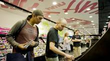 Customer Roger Oegema, left, is helped by HMV assistant manager, Jerry Medeiros in a Toronto HMV outlet. (Sarah Dea/Sarah Dea)