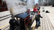 Amir Azizov, 4, reacts as steam is blown from the whistle of the Toronto Railway Historical Association's live steam miniature railway in the Roundhouse Park in Toronto on April 20, 2012, volunteer Mike Salisbury. The TRHA rebuilds trains engines and cars in three bays of the roundhouse on John Street, and has outdoor exhibits but was planning to build the centrepiece, a museum with interactive trains, archives and other items donated to the association in what is called the machine shop, which is now being taken over by Toronto Hydro, who are planning to build a transformer in the building, leaving the museum with no home. (Deborah Baic/The Globe and Mail/Deborah Baic/The Globe and Mail)