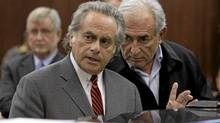 International Monetary Fund (IMF) chief Dominique Strauss-Kahn, right, talks with his lawyer Benjamin Brafman during his arraignment in Manhattan Criminal Court in New Yorkm May 16, 2011. (Reuters/Reuters)