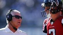 Atlanta Falcons head coach Mike Smith talks with quarterback Matt Ryan (2) during their NFL football game against the San Diego Chargers in San Diego, Calif. Sept. 23, 2012. (Mike Blake/REUTERS)