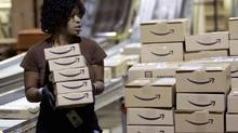 Amazon's U.S. distribution centres currently employ about 20,000 workers who pack and ship customer orders. (TIM SHAFFER/REUTERS)