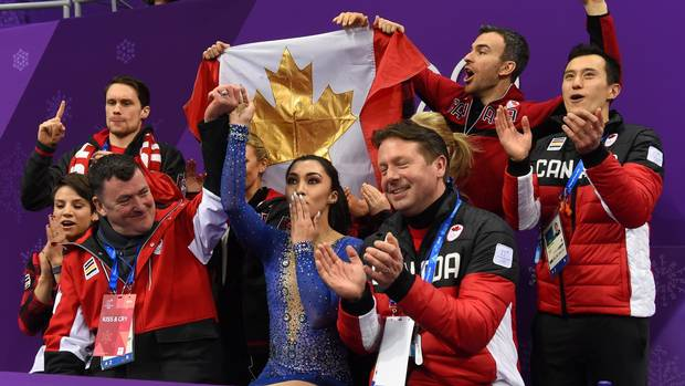 Canada's Gabrielle Daleman (front C) reacts after competing in the figure skating team event women's single skating free skating during the Pyeongchang 2018 Winter Olympic Games at the Gangneung Ice Arena in Gangneung on February 12, 2018.