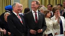 Minister of Justice Peter MacKay (second left) shares a laugh with Minister of National Defence Rob Nicholson (left) July 15, 2013 during a swearing in ceremony at Rideau Hall in Ottawa. (Dave Chan/The Globe and Mail)