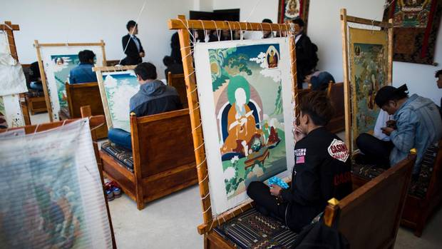 Students practise traditional thangka painting, minutely detailed works depicting Buddhist deities or symbols, at the Danba Raodan art school on Sept. 10.