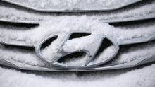 The logo of Hyundai Motor on a sedan is covered with snow at a shipping yard of South Korea's biggest auto maker Hyundai Motor Co. (KIM HONG-JI/REUTERS)