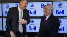 Bell Canada Enterprises (BCE) President and Chief Executive Officer George Cope (left) and Astral Media Inc. President and Chief Executive Officer Ian Greenberg share a laugh after a news conference in Montreal March 16, 2012. (CHRISTINNE MUSCHI/REUTERS)