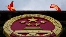 China appears increasingly sure of its economic role in the world, despite a new revised gross domestic product growth target of 7.5 per cent that is the lowest in nine years. (Andy Wong/Associated Press/Andy Wong/Associated Press)