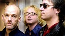 R.E.M. members (from left) Michael Stipe, Mike Mills and Peter Buck in London in 2001. (AFP)