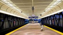 A passenger waits for the Skytrain at the Gateway Skytrain Station in Surrey, B.C. (Rafal Gerszak for the Globe and Mail)