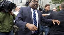 Raj Rajaratnam, co-founder of Galleon Group LLC, leaves Federal Court after his sentencing on Thursday, Oct. 13, 2011 in New York. (Jin Lee/AP)