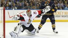 Ottawa Senators goalie Craig Anderson (41) makes a save as Buffalo Sabres right wing Drew Stafford (21) looks for a rebound during the second period at First Niagara Center. (Kevin Hoffman/USA TODAY Sports)